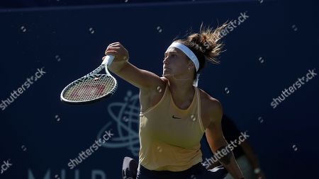 Aryna Sabalenka, of Belarus, returns a shot to CoCo Vandeweghe, of the United States, during the Mubadala Silicon Valley Classic tennis tournament in San Jose, Calif