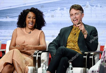 """Simone Missick, Wilson Bethel. Simone Missick, left, and Wilson Bethel, cast members in the CBS series """"All Rise,"""" share a laugh onstage during the Summer 2019 Television Critics Association Press Tour at the Beverly Hilton, in Beverly Hills, Calif"""