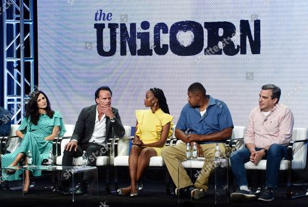 """Michaela Watkins, Walton Goggins, Maya Lynne Robinson, Omar Miller, Mike Schiff. From left, """"The Unicorn"""" cast members Michaela Watkins, Walton Goggins, Maya Lynne Robinson, Omar Miller and executive producer Mike Schiff take part in a panel discussion on the CBS series during the Summer 2019 Television Critics Association Press Tour at the Beverly Hilton, in Beverly Hills, Calif"""