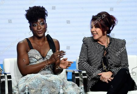 """Ito Aghayere, Patricia Heaton. Ito Aghayere, left, a cast member in the CBS series """"Carol's Second Act,"""" answers a question as star/executive producer Patricia Heaton looks on during the Summer 2019 Television Critics Association Press Tour at the Beverly Hilton, in Beverly Hills, Calif"""