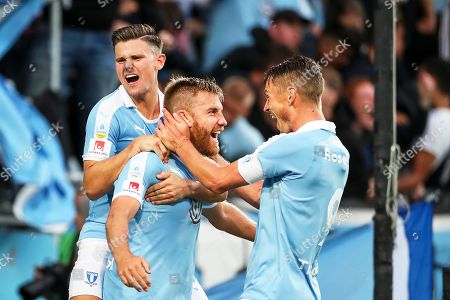 Malmo's Rasmus Bengtsson (C) celebrates with his teammates Marcus Antonsson (L) and Markus Rosenberg (R) after scoring the 3-2 lead during the UEFA Europa League second qualifying round, second leg soccer match between Malmo FF and NK Domzale in Malmo, Sweden, 01 August 2019.