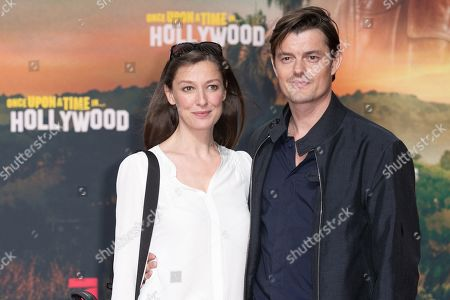 Alexandra Maria Lara (L) and her husband, British actor Sam Riley pose during the German premiere of 'Once Upon a Time in... Hollywood' in Berlin, Germany, 01 August 2019. The movie opens in German cinemas on 15 August.