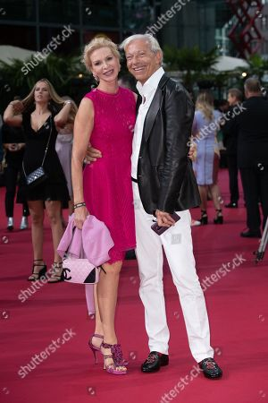 Stock Picture of German media psychologist Jo Groebel (R) and wife Grit Weiss pose during the German premiere of 'Once Upon a Time in... Hollywood' in Berlin, Germany, 01 August 2019. The movie opens in German cinemas on 15 August.