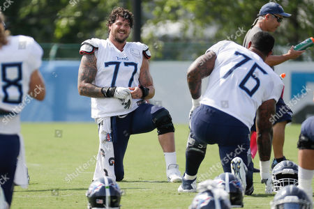 Tennessee Titans offensive tackle Taylor Lewan (77) talks with offensive guard Rodger Saffold (76) during NFL football training camp, in Nashville, Tenn