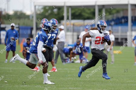 New York Giants' Paul Perkins (28) runs during drills at the NFL football team's training camp, in East Rutherford, N.J