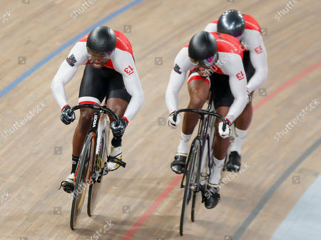 Trinidad and Tobago's Keron Bramble, Paul Nicholas and Njisane Phillip pedal to win the gold medal in the cycling track men's team sprint final at the Pan American Games in Lima, Peru
