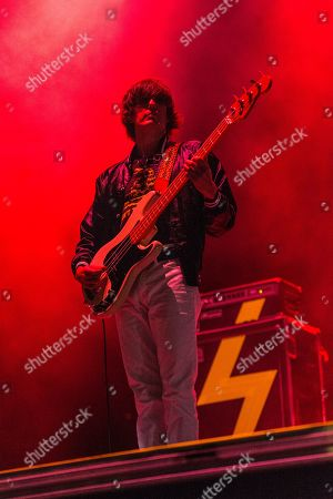 Nikolai Fraiture of The Strokes performs on day one of Lollapalooza in Grant Park, in Chicago