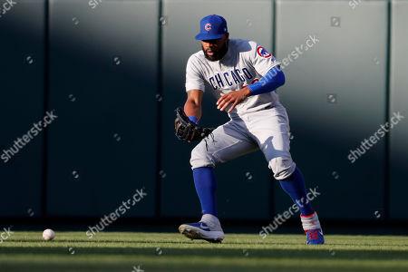 Chicago Cubs center fielder Jason Heyward picks up a single by St. Louis Cardinals' Kolten Wong during the second inning of a baseball game, in St. Louis