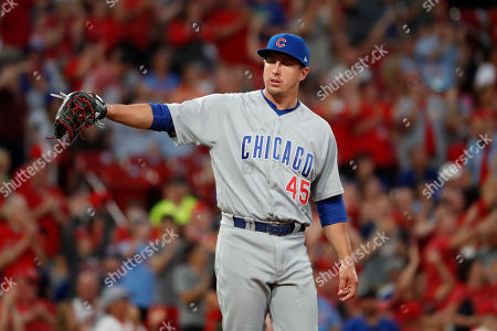 Stock Image of Chicago Cubs relief pitcher Derek Holland stands on the mound after giving up a three-run home run to St. Louis Cardinals' Matt Wieters during the sixth inning of a baseball game, in St. Louis