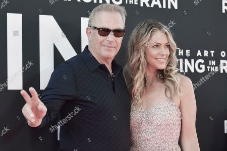 "Kevin Costner, Christine Baumgartner. Kevin Costner, left, and Christine Baumgartner attend the LA premiere of ""The Art of Racing in the Rain"" at the El Capitan Theatre, in Los Angeles"