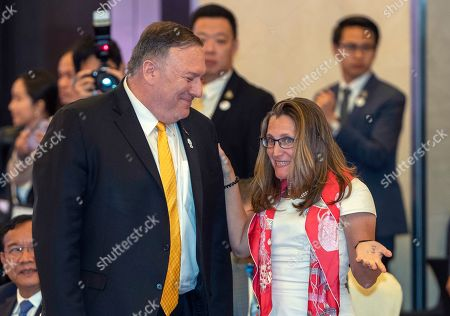 Mike Pompeo, Chrystia Freeland. U.S. Secretary of State Mike Pompeo, left, and Canada's Foreign Minister Chrystia Freeland, right, greet each other ahead of the Association of Southeast Asian Nations Regional Forum in Bangkok, Thailand