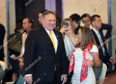 Stock Image of Mike Pompeo, Chrystia Freeland. U.S. Secretary of State Mike Pompeo, left, and Canada's Foreign Minister Chrystia Freeland, right, greet each other ahead of the Association of Southeast Asian Nations Regional Forum in Bangkok, Thailand