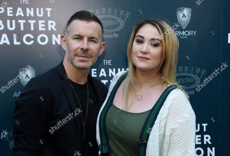 "Bradley Bredeweg, Emma Hunton. Bradley Bredeweg, left, and Emma Hunton attend the LA Special Screening of ""The Peanut Butter Falcon"" at The ArcLight Hollywood, in Los Angeles"