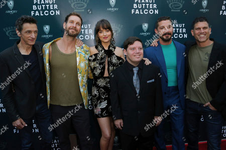 "Stock Picture of John Hawkes, Tyler Nilson, Dakota Johnson, Zack Gottsagen, Shia LaBeouf, Michael Schwartz. John Hawkes, from left, Tyler Nilson, Dakota Johnson, Zack Gottsagen, Shia LaBeouf and Michael Schwartz attend the LA Special Screening of ""The Peanut Butter Falcon"" at The ArcLight Hollywood, in Los Angeles"