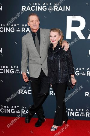 Maxwell Caulfield (L) and his wife British actress Juliet Mills (R) arrive for the premiere of The Art of Racing in the Rain at the El Capitan Theatre in Hollywood, Los Angeles, California, USA, 01 August 2019. The movie opens in US cinemas on 09 August 2019.