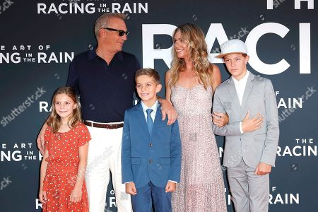 Stock Image of Kevin Costner (2-L), his wife Christine Baumgartner (2-R) and their children arrive for the premiere of The Art of Racing in the Rain at the El Capitan Theatre in Hollywood, Los Angeles, California, USA, 01 August 2019. The movie opens in US cinemas on 09 August 2019.