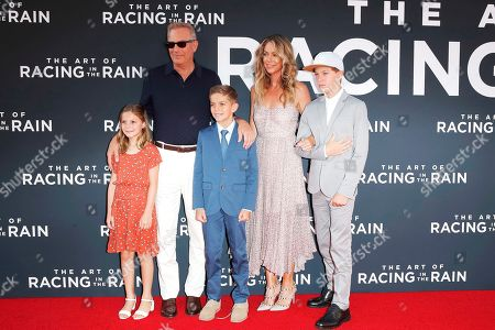 Stock Picture of Kevin Costner (2-L), his wife Christine Baumgartner (2-R) and their children arrive for the premiere of The Art of Racing in the Rain at the El Capitan Theatre in Hollywood, Los Angeles, California, USA, 01 August 2019. The movie opens in US cinemas on 09 August 2019.