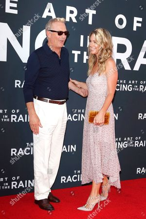 Stock Photo of Kevin Costner (L) and his wife Christine Baumgartner (R) arrive for the premiere of The Art of Racing in the Rain at the El Capitan Theatre in Hollywood, Los Angeles, California, USA, 01 August 2019. The movie opens in US cinemas on 09 August 2019.