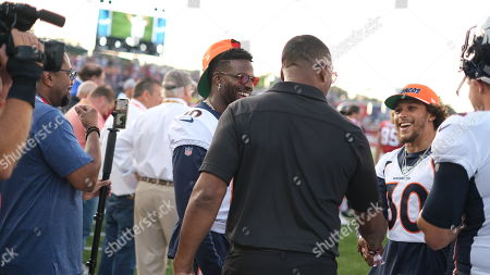 st, Chris Carter talking with Emmanuel Sanders #10, and Phillip Lindsay #30 during the Atlanta Falcons vs Denver Broncos game at the Pro Football Hall of Fame Game in Canton, OH