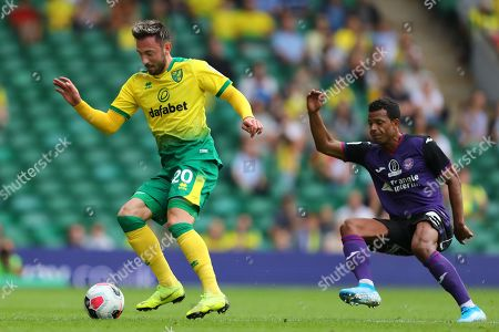 Josip Drmic of Norwich City and Mathieu Dossevi of Toulouse - Norwich City v Toulouse, Pre-Season Friendly, Carrow Road, Norwich, UK - 3rd August 2019