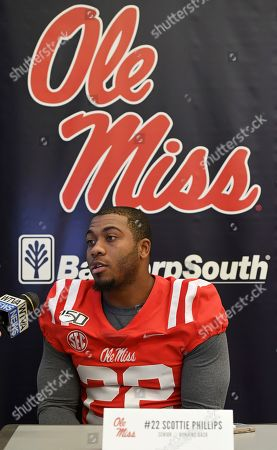 Mississippi running back Scottie Phillips talks to reporters during a media day interview in Oxford, Miss