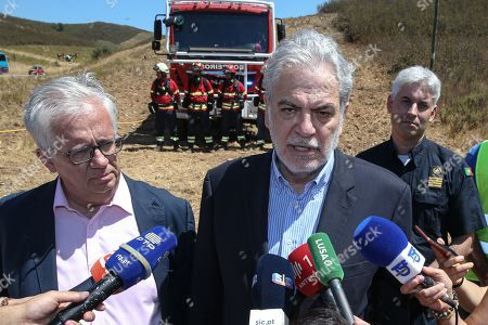 European Commissioner for Humanitarian Aid and Crisis Management Christos Stylianides (C) with Portuguese Minister of Internal Administration Eduardo Cabrita (L), during a press conference at the end of the commissioner's visit to Portimo, Portugal, 02 August 2019.