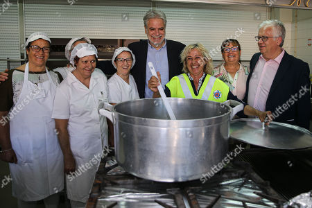 Stock Image of European Commissioner for Humanitarian Aid and Crisis Management Christos Stylianides (C) with Portuguese Minister of Internal Administration Eduardo Cabrita (R), with volunteers during a visit to Portimo, Portugal, 02 August 2019.