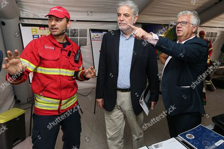 European Commissioner for Humanitarian Aid and Crisis Management Christos Stylianides (C) with Portuguese Minister of Internal Administration Eduardo Cabrita (R), talk to a firefighter during a visit to Portimo, Portugal, 02 August 2019.