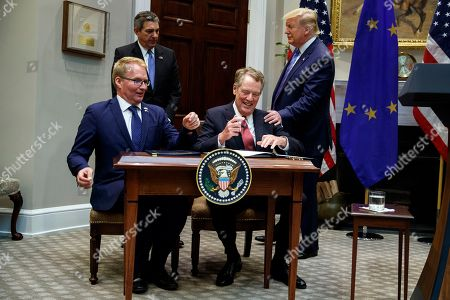 Donald Trump, Robert Lighthizer, Jani Raappana, Stavros Lambrindis. President Donald Trump pats U.S. Trade Representative Robert Lighthizer on the shoulder as he signs an agreement expanding U.S. beef exports to the European Union, in the Roosevelt Room of the White House, in Washington. From left, Jani Raappana, Deputy Head of Mission, for the Finnish Presidency of the Council of the EU, European Union Ambassador Stavros Lambrinidis, Lighthizer, and Trump