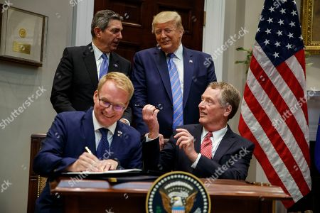 Donald Trump, Robert Lighthizer, Jani Raappana, Stavros Lambrindis. President Donald Trump talks with European Union Ambassador Stavros Lambrinidis as U.S. Trade Representative Robert Lighthizer, right, and Jani Raappana, Deputy Head of Mission, for the Finnish Presidency of the Council of the EU sign an agreement expanding U.S. beef exports to the European Union, in the Roosevelt Room of the White House, in Washington