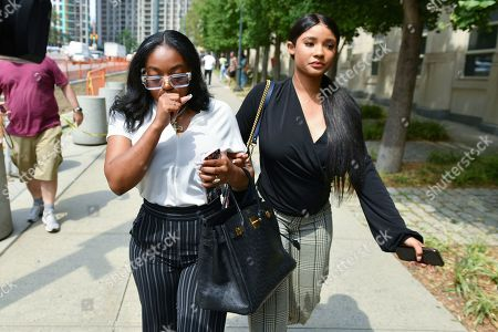 Azriel Clary and Joycelyn Savage leave Brooklyn Federal Court after R. Kelly was arraigned on racketeering charges.