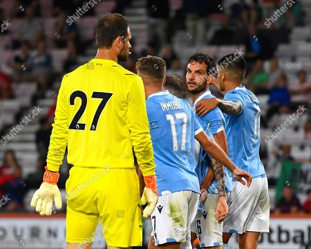 Stock Picture of Marco Parolo of Lazio second right looks at AFC Bournemouth keeper Asmir Begovic  after scoring the third goal during AFC Bournemouth vs SS Lazio, Friendly Match Football at the Vitality Stadium on 2nd August 2019