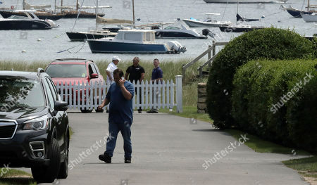 People stand inside the Kennedy compound, in Hyannis Port, Mass. Saoirse Kennedy Hill, granddaughter of Ethel Kennedy and her late husband Robert F. Kennedy, died at the compound on Thursday. She was 22
