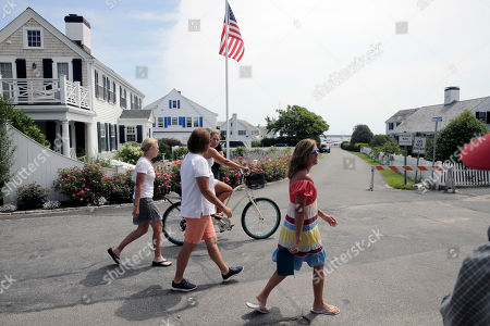 People walk past the street leading to the Kennedy compound, in Hyannis Port, Mass. Saoirse Kennedy Hill, granddaughter of Ethel Kennedy and her late husband Robert F. Kennedy, died at the compound on Thursday. She was 22
