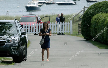 A woman walks up the street leading from the Kennedy compound, in Hyannis Port, Mass. Saoirse Kennedy Hill, granddaughter of Ethel Kennedy and her late husband Robert F. Kennedy, died at the compound Thursday. She was 22