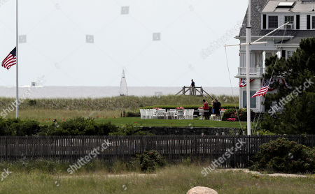An American flags flies at half staff as people gather at the Kennedy compound, in Hyannis Port, Mass. Saoirse Kennedy Hill, granddaughter of Ethel Kennedy and her late husband Robert F. Kennedy, died at the compound Thursday. She was 22