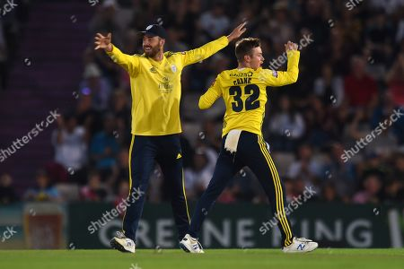 James Vince and Mason Crane of Hampshire celebrate the wicket of David Lloyd during the Vitality T20 Blast South Group match between Hampshire County Cricket Club and Glamorgan County Cricket Club at the Ageas Bowl, Southampton