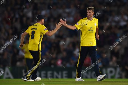 Chris Morris and Liam Dawson of Hampshire celebrate the wicket of Graham Wagg during the Vitality T20 Blast South Group match between Hampshire County Cricket Club and Glamorgan County Cricket Club at the Ageas Bowl, Southampton