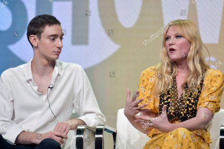 """Stock Image of Theodore Pellerin, Kirsten Dunst. Theodore Pellerin, left, and Kirsten Dunst participate in the Showtime """"On Becoming a God in Central Florida"""" panel during the Summer 2019 Television Critics Association Press Tour at the Beverly Hilton Hotel, in Beverly Hills, Calif"""