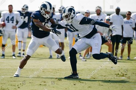 Stock Image of Darious Williams, Johnathan Lloyd. Los Angeles Rams defensive back Darious Williams, right, works against wide receiver Johnathan Lloyd during an NFL football training camp in Irvine, Calif