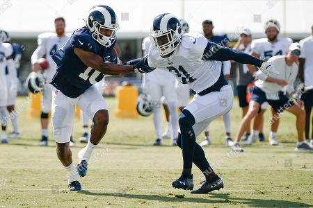 Darious Williams, Johnathan Lloyd. Los Angeles Rams defensive back Darious Williams, right, works against wide receiver Johnathan Lloyd during an NFL football training camp in Irvine, Calif
