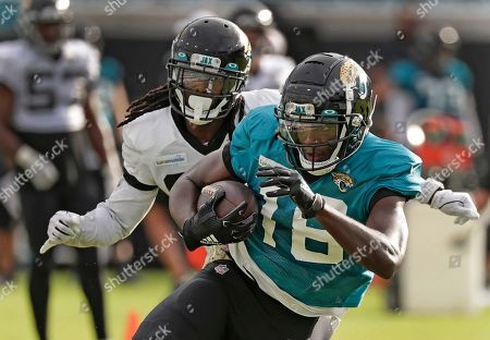 Chris Conley, Tre Herdon. Jacksonville Jaguars wide receiver Chris Conley, right, makes a reception in front of cornerback Tre Herdon during a scrimmage at an NFL football practice at the teams stadium, in Jacksonville, Fla