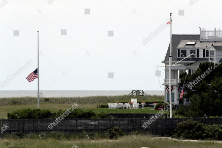 Stock Picture of A flag flies at half-staff at the Kennedy compound, in Hyannis Port, Mass. Saoirse Kennedy Hill, granddaughter of Ethel Kennedy and her late husband Robert F. Kennedy, died at the compound Thursday. She was 22