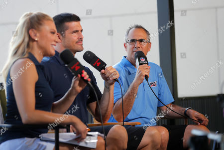 NFL Network show host Amber Theoharis, analyst David Carr and reporter Michael Silver on the set during the New Orleans Saints training camp at their NFL football training facility in Metairie, La
