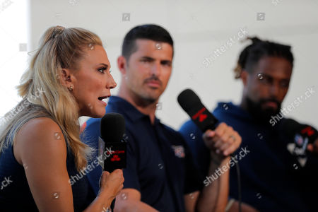 NFL Network show host Amber Theoharis, with analyst David Carr and New Orleans Saints defensive end Cameron Jordan, right, on the set during the Saints training camp at their NFL football training facility in Metairie, La