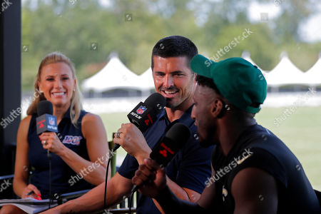 Stock Picture of NFL Network show host Amber Theoharis, with analyst David Carr and New Orleans Saints wide receiver Michael Thomas, right, on the set during the Saints training camp at their NFL football training facility in Metairie, La