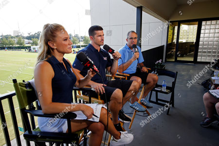 Stock Image of NFL Network show host Amber Theoharis, analyst David Carr and reporter Michael Silver on the set during the New Orleans Saints training camp at their NFL football training facility in Metairie, La
