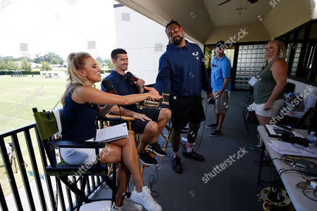 NFL Network show host Amber Theoharis, analyst David Carr and New Orleans Saints defensive end Cameron Jordan, right, on the set during the Saints training camp at their NFL football training facility in Metairie, La