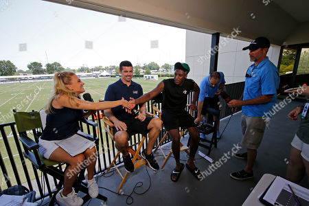NFL Network show host Amber Theoharis, with analyst David Carr and New Orleans Saints wide receiver Michael Thomas, right, on the set during the Saints training camp at their NFL football training facility in Metairie, La