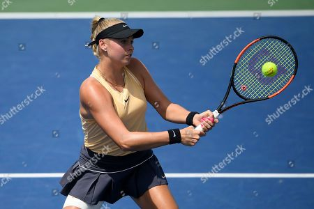 Fanny Stollar, of Hungary, returns the ball as she and Maria Sanchez played a doubles match in the Citi Open tennis tournament against Yafan Wang, and Zhaoxuan Yang, both of China, in the Citi Open tennis tournament, in Washington